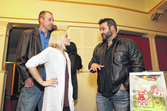 """Austin St. John, an actor in """"A Walk With Grace,"""" greets guests Kayla Lones and Matthew Treadway during the movie premiere at the Wapa Theater on Wednesday evening."""