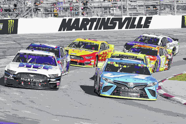 Martin Truex Jr. (19) and Clint Bowyer (14) lead the field in turn four during a restart of the NASCAR Cup Series race at Martinsville Speedway in Martinsville, Va., Sunday, Oct. 27, 2019. (AP Photo/Steve Helber)