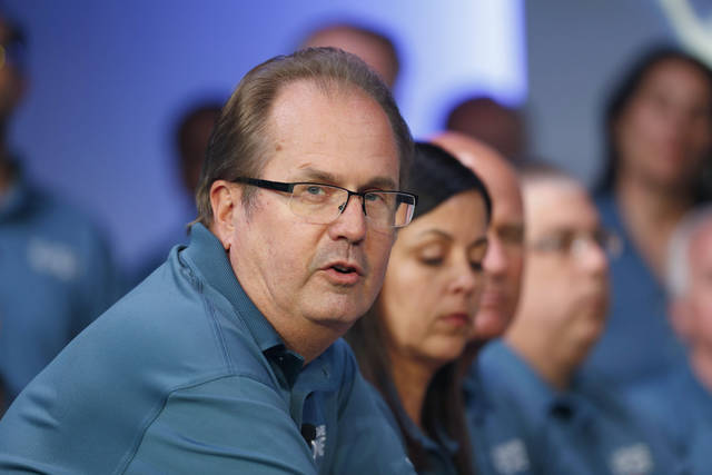 FILE - In this July 16, 2019, file photo, Gary Jones, United Auto Workers President, speaks during the opening of their contract talks with Fiat Chrysler Automobiles in Auburn Hills, Mich.   Jones is taking a paid leave of absence amid a federal investigation of corruption in the union. The UAW said Jones requested the leave, which is effective Sunday, Nov. 3. The federal government has been investigating fraud and misuse of funds at the UAW for more than two years. (AP Photo/Paul Sancya, File)