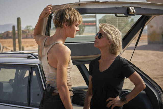"This image released by Paramount Pictures shows Mackenzie Davis, left, and Linda Hamilton in ""Terminator: Dark Fate."" (Kerry Brown/Paramount Pictures via AP)"