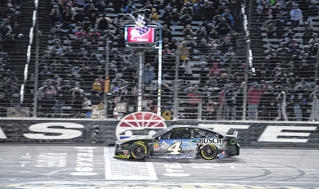Kevin Harvick (4) crosses the finish line to win a NASCAR Cup Series auto race at Texas Motor Speedway, Sunday, Nov. 3, 2019, in Fort Worth, Texas. (AP Photo/Larry Papke)