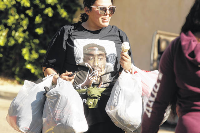 People line up around the block of singer Chris Brown's home in the Tarzana area of Los Angeles on Wednesday. Brown said he was having a high-end yard sale at his Los Angeles home.