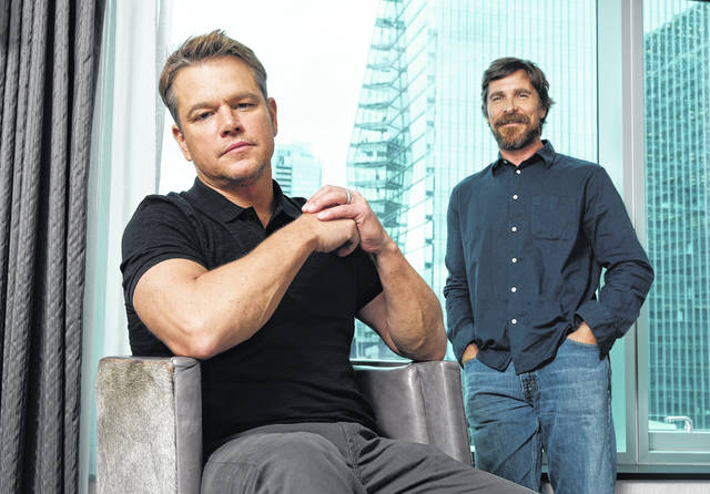 """Co-stars Matt Damon, left, and Christian Bale posing for a portrait in September to promote their film """"Ford v Ferrari,"""" at the St. Regis Hotel during the Toronto International Film Festival. The film, directed by James Mangold, hits theaters on Nov. 15."""