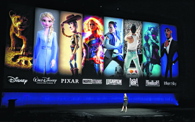 Characters from Disney and Fox movies are displayed behind Cathleen Taff, president of distribution, franchise management, business and audience insight for Walt Disney Studios in April. A new survey shows cord-cutters would pay more for the right streaming services.