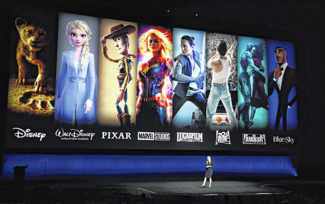 Characters from Disney and Fox movies are displayed behind Cathleen Taff, president of distribution, franchise management, business and audience insight for Walt Disney Studios during the Walt Disney Studios Motion Pictures presentation at CinemaCon 2019. On Tuesday, Disney Plus launched its streaming service, with some technical difficulties.