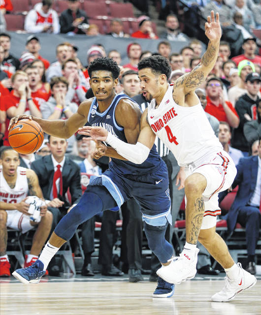 Villanova's Jermaine Samuels, left, tries to dribble past Ohio State's Duane Washington during the first half of an NCAA college basketball game Wednesday, Nov. 13, 2019, in Columbus, Ohio. (AP Photo/Jay LaPrete)