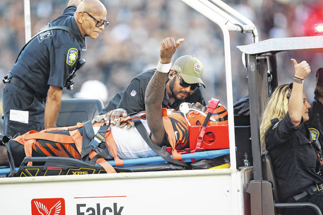 Cincinnati Bengals wide receiver Auden Tate flashes a thumbs up while being carried off the field during the second half of an NFL football game against the Oakland Raiders in Oakland, Calif., Sunday, Nov. 17, 2019. (AP Photo/Ben Margot)