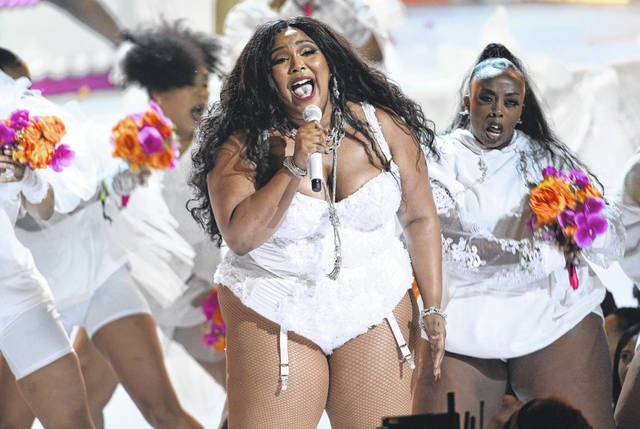 Lizzo performs at the BET Awards on June 23 in Los Angeles. The singer-rapper earned eight Grammy Award nominations Wednesday, Nov. 20, making her the show's top-nominated act. The 62nd Grammy Awards will air live from the Staples Center in Los Angeles on Jan. 26.