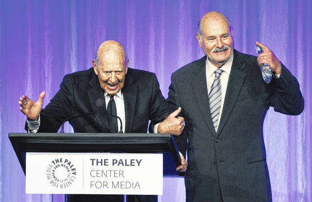 """Honoree Carl Reiner, left, is joined by his son, Rob Reiner, as he accepts his award at """"The Paley Honors: A Special Tribute to Television's Comedy Legends"""" at the Beverly Wilshire Hotel on Thursdayin Beverly Hills, Calif."""