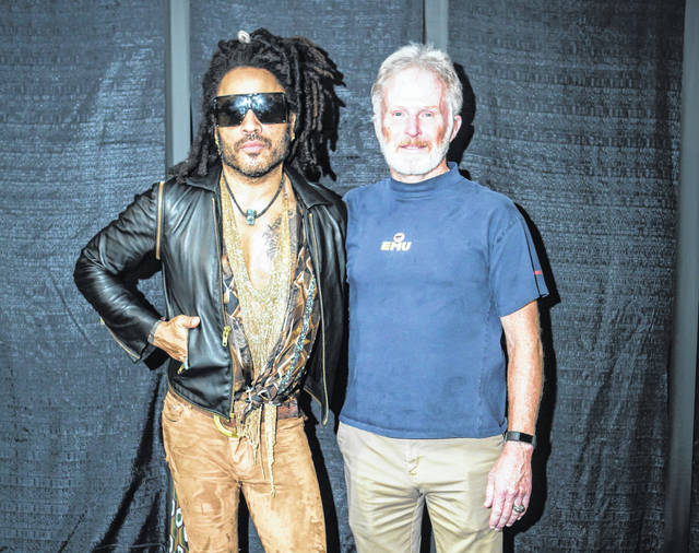 Lenny Kravitz, the headliner at this year's Spookstock concert, poses with Army Gen. Tony Thomas, former commander of U.S. Special Operations Command, at the annual Spookstock event. The annual charitable event, held each year in an undisclosed Washington location, has become a centerpiece for Washington's tight-knit intelligence-military special operations community. It has raised millions to fund higher education for the children of CIA field officers and special operations soldiers killed on duty.