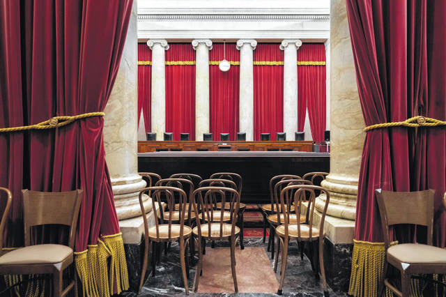 The empty courtroom is seen at the U.S. Supreme Court in Washington in June. The lack of transparency at the Supreme Court begins with the heavy red drapes that frame the courtroom on all sides. The court replaced the drapes this summer, but it would not reveal the name of the company that did the work. Basic details about how the court operates remain obscured.