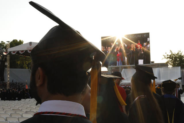 Graduates enter Sanford Stadium during the University of Georgia's spring commencement in Athens, Ga. The first student loan bills are arriving for the Class of 2019. If the grads are able to stick to the standard plan, they'll make payments every month for the next 10 years and be done with it.