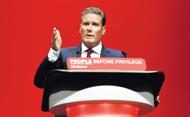 FILE - In this Monday, Sept. 23, 2019 file photo, Britain's Shadow Brexit Secretary Keir Starmer speaks on stage during the Labour Party Conference at the Brighton Centre in Brighton, England. On Friday, Nov. 8, 2019, The Associated Press reported on an altered video circulating online incorrectly asserting Starmer was too stumped to answer a question about the EU deal. The footage was intentionally altered and posted by British Prime Minister Boris Johnson's Conservatives onto social media on Nov. 5.