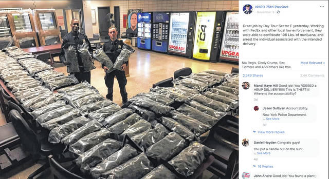 In this undated photo taken from the New York Police Department Facebook page, officers stand by what NYPD thought was marijuana when they confiscated in the Brooklyn borough of New York on Saturday, Nov. 2, 2019, at the 75th Precinct of the NYPD in New York. The Vermont farm that grew the plants and the Brooklyn CBD shop that ordered them insist it's not pot, but legal industrial hemp.