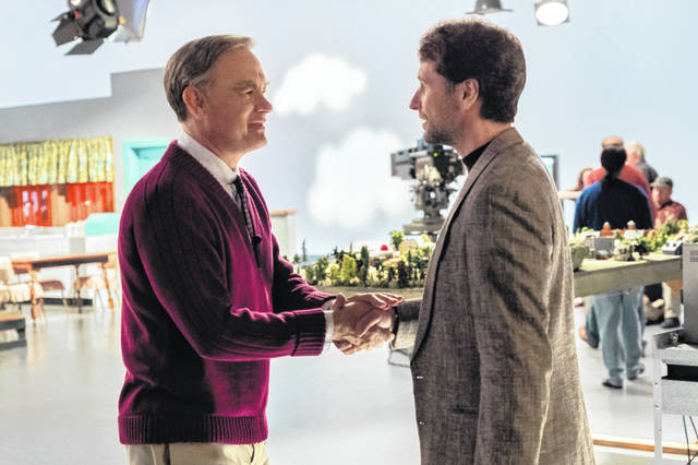 """Tom Hanks, left, plays Fred Rogers in this scene with Matthew Rhys in """"A Beautiful Day In the Neighborhood."""""""