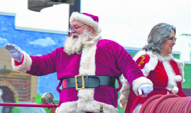 Santa and Mrs. Claus rode atop an antique fire truck in the Bluffton Blaze of Lights Parade.