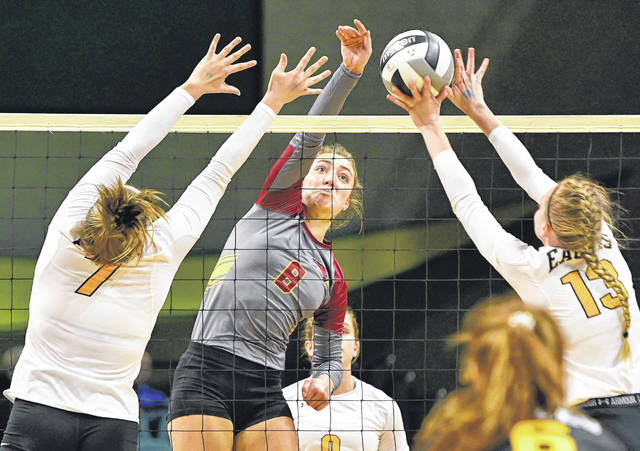 New Bremen's Macy Puthoff (8) sends a spike over the net during a Division IV state semifinal against Monroeville on Friday at Wright State University's Nutter Center in Fairborn.