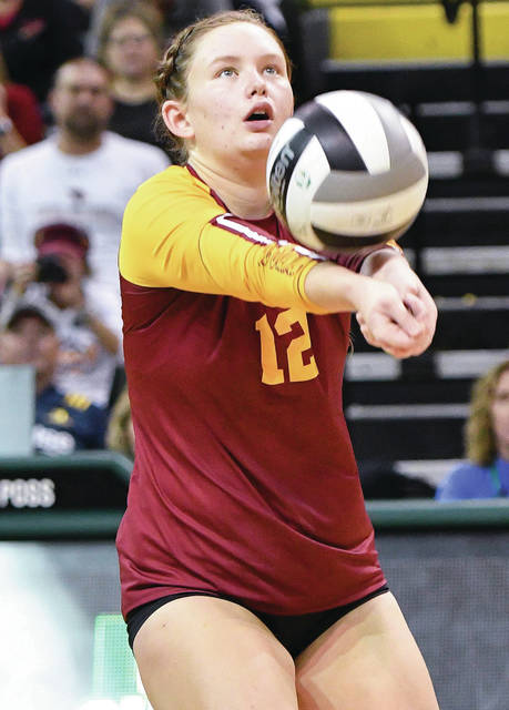 New Bremen's Claire Pape keeps the allive with a bump during Saturday's Division IV state championship match at Wright State University's Nutter Center in Fairborn.