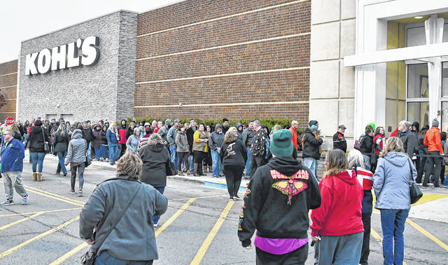 Shoppers wait in line at Kohl's to enter the store on Thanksgiving Day last year.  Richard Parrish | The Lima News