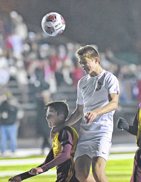 Bluffton's Kaden Basil keeps the ball away from South Range's Jackson Yeagley during Wednesday night's Division III state semifinal in Doylestown.