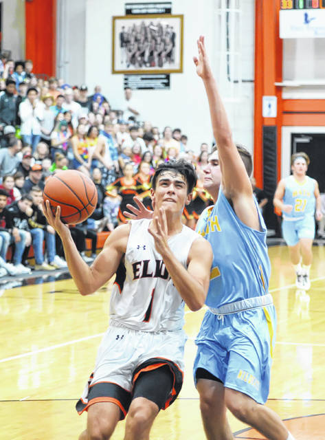 Elida's Dylan Buetner drives against Bath's Landyn Fleharty during Friday night's Mercy Health Tip Off Tournament at the Elida Fieldhouse.