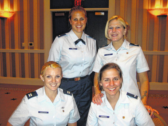 "When Pandora-Gilboa graduate Theresa Schroeder Hageman (top row, left) entered the Air Force in 2005, the daily uniform for those studying to be nurses was the Air Force blues, or what many called ""office wear."""