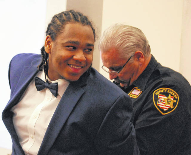 Chaz Jackson was all smiles as he talked briefly with family members before leaving a Lima courtroom for a recess during his murder trial Wednesday.