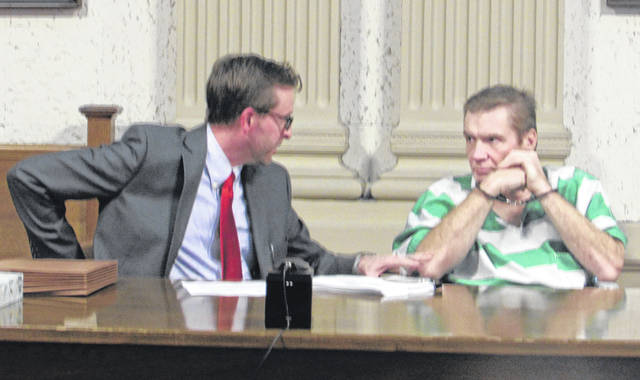 Alex Treece, attorney, talks with his client Kenneth Richey in Putnam County Common Pleas Court Monday.