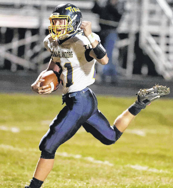 Clayton Recker, here celebrating scoring a touchdown at Kenton during the regular season, and his Ottawa-Glandorf teammates open Division IV postseason play Saturday at Galion.