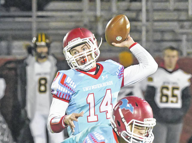 Lima Central Catholic's Nevan Stolly throws a pass during Friday night's Division VI quarterfinal against Fairview at Spartan Stadium.