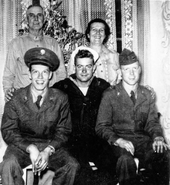 "This picture was taken during the Christmas holiday in 1952. Front, from left: Herbert Shoemaker (Army), brothers Serge Ladd (Navy) and Robert ""Bob"" Ladd (Army). Back: Jim and Cora Shoemaker, parents of Herbert. All are deceased except Serge."