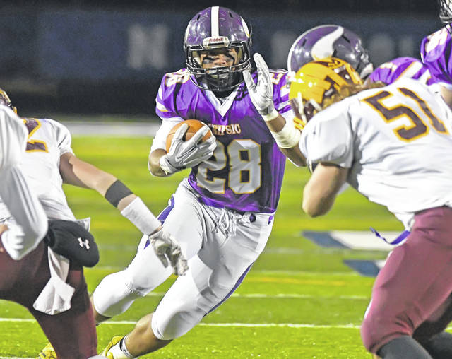 Leipsic's Lorenzo Walther looks for room to gain more yardage during Saturday night's Division VII regional semifinal against Edgerton at Charles Buckenmeyer Stadium in Napoleon. The Vikings went on to win 39-6 and will play Patrick Henry for the Region 26 championship at 7 p.m. Saturday at Defiance High School.