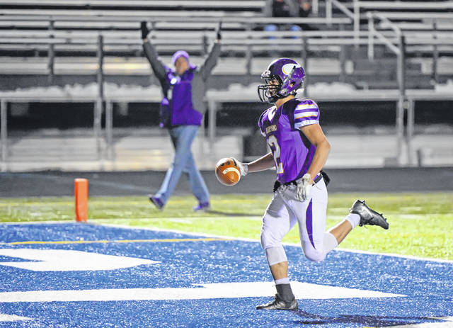 Leipsic's Fabian Pena scores a touchdown during Saturday's night's Division VII regional semifinal against Edgerton at Charles Buckenmeyer Stadium in Napoleon.