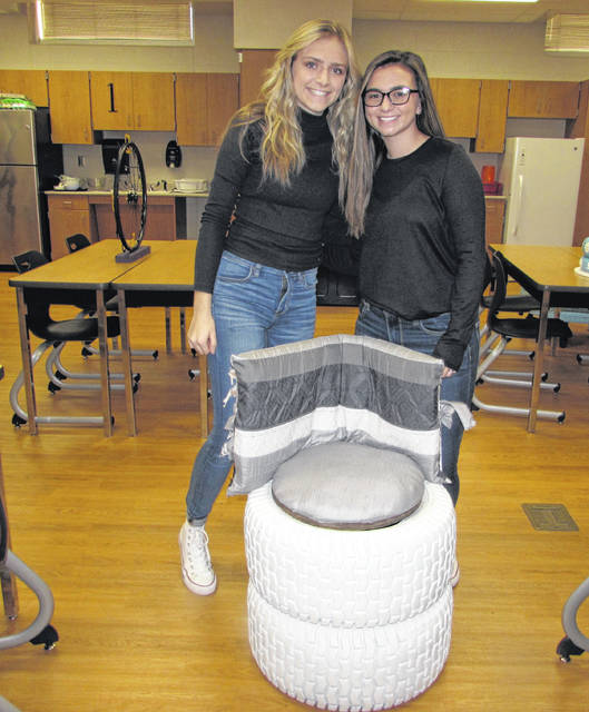 Pictured from left are Lydia Apple and Morgan Schroeder, Leipsic High School seniors, with an ottoman and chair they made from repurposed materials.