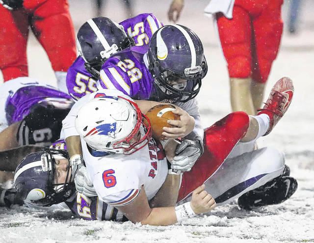 Leipsic's Evan Schroeder (67), Lorenzo Walther (28) and Grant Steingass (55) combine to stop Patrick Henry's Will Morrow during Saturday night's Division VII regional final at Defiance High School.