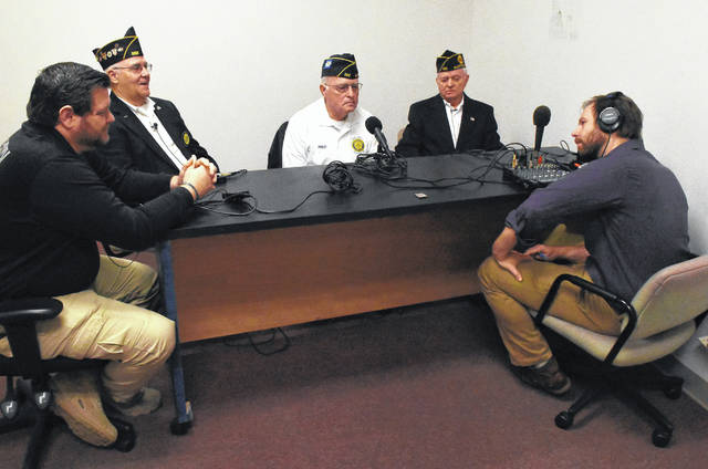 Area veterans meet at The Lima News for a discussion about their experiences. From left to right are Chad Cupples, Dennis Morrison, Fred Radabaugh and Bob Town. Craig J. Orosz | The Lima News