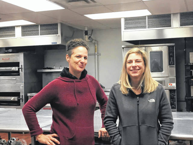 Melanie Kirchenbauer (left) and Alisa McPheron are bringing back Fat Cat, selling chef ready made meals at the Civic Center as the duo build their ecommerce venture, Perfect Cheesecake Bakeware.