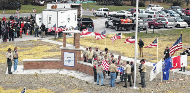 A large crowd gathered Saturday for the dedication of a memorial honoring Medal of Honor recipient William E. Metzger Jr.