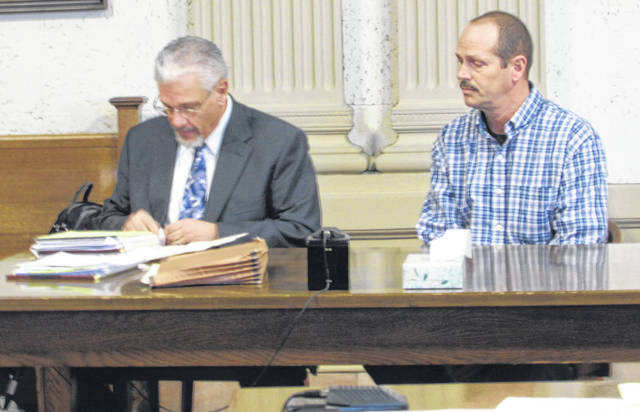 From left are attorney E. Charles Bates and his client Michael Huizenga who is accussed of having sexual contact with a juvenile less than 13 years old every year since 2013 in Putnam County.