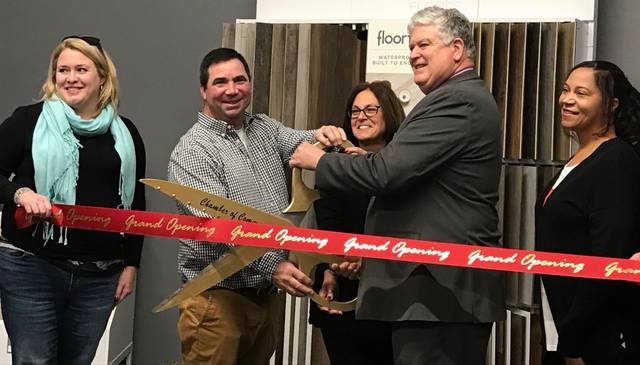 John Sreenan (second from left) and Jill Sreenan (center) unveil Northwest Flooring Gallery, a 1,250 square foot showroom on Spring Street, during a ribbon cutting Nov. 14.