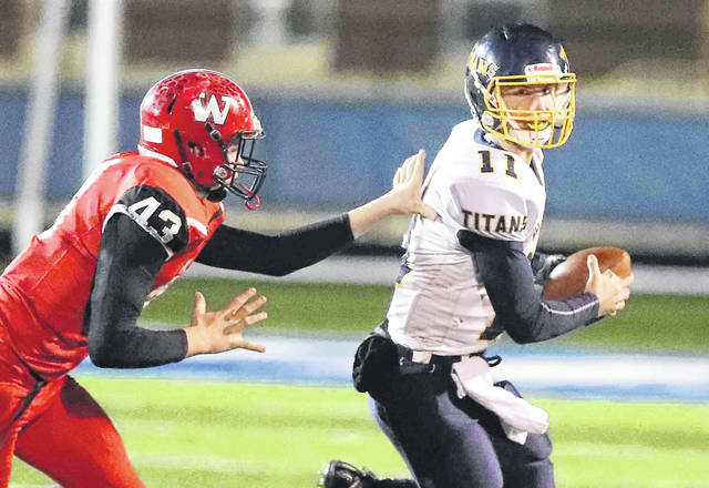 Ottawa-Glandorf's Jacob Balbaugh tries to get away from Wauseon's Isaac Wilson during Saturday night's Division IV regional semifinal at Defiance High School.