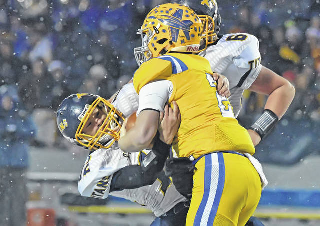 Ottawa-Glandorf's Cy Rump tackles Clyde's Ryan Lozier during Saturday night's Division IV regional final at JC Donnell Memorial Stadium in Findlay.