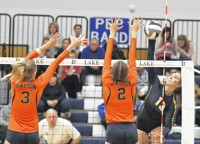 Ottawa-Glandorf's Erica Annesser hits a spike against Galion's Taylor Keeran, left, and Kerrigan Myers during a Thursday Division III regional semifinal at Lake High School in Millbury.