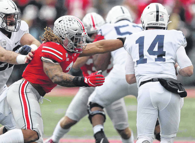Ohio State's Chase Young closes in on Penn State's Sean Clifford (14) during Saturday's game at Ohio Stadium in Columbus.
