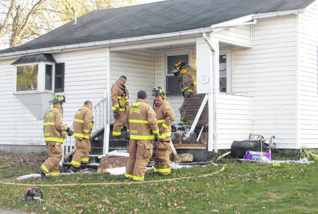 Ottawa Fire Department personnel work to put out a porch fire Thursday afternoon on Third Street in Ottawa.