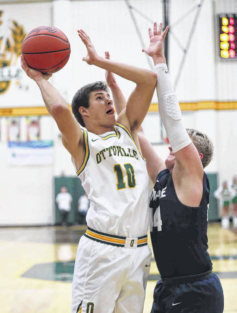 Ottoville's Grant Kortokrax puts up a shot against Temple Christian's Lincoln Waters during Friday night's game in the L.W. Heckman Gymnasium in Ottoville.