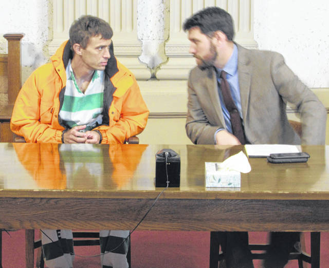 James Phillips speaks to his attorney Chris Woodworth on Thursday in Putnam County Common Pleas Court.