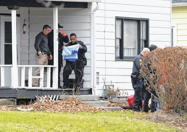 Officers investigate the scene of a shooting at 318 E. Second St. on Tuesday around 3:50 p.m.