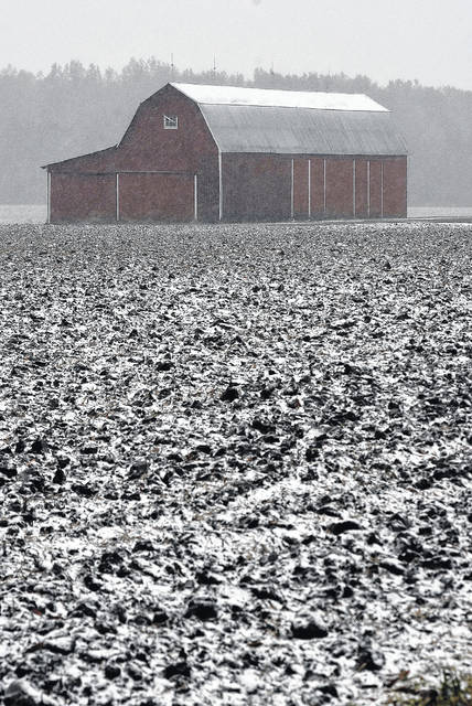 Snow accumulates on newly tilled farm ground off of Fort Amanda Road in Allen County on Monday afternoon.
