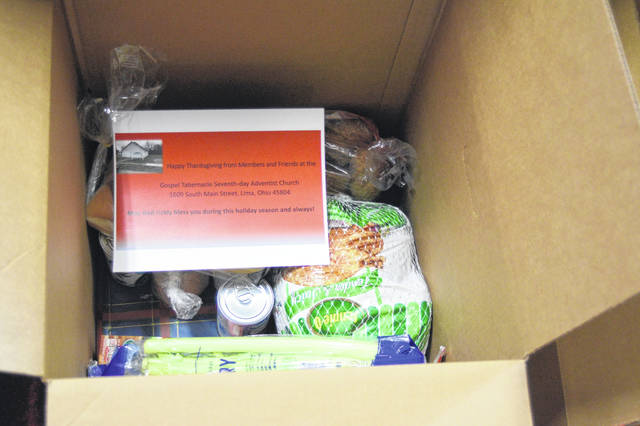 Ten boxes were filled with food to be distributed to 10 needy sixth ward Lima families.